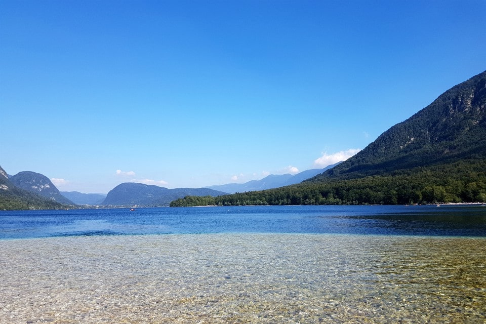 A popular swimming beach at Lake Bohinj in Slovenia