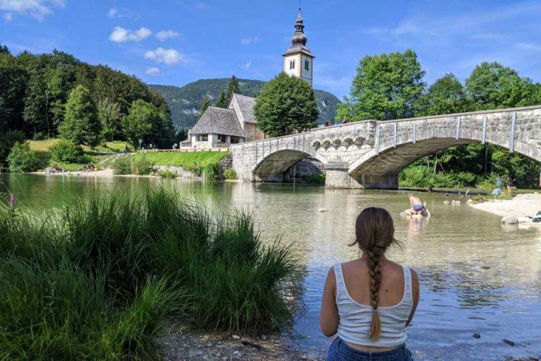 Enjoy a view of the church as you walk around Lake Bohinj in Slovenia