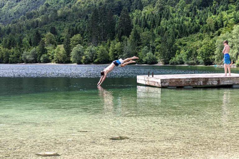 Teenagers love to swim at the floating platform at Lake Bohinj
